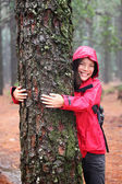 Happy female tree hugger — Stockfoto