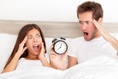 Oversleeping - horrified couple have overslept — Stock Photo