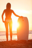Surfer beach woman with water sport bodyboard — Stock Photo