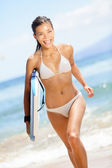 Surfing beach woman - happy surfer girl running — Stock Photo