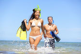 Happy couple beach summer vacation travel fun — Stock Photo