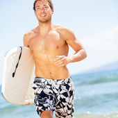 Handsome man surfer fun on summer beach — Stock Photo