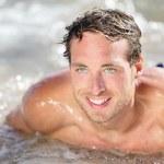 Beach man having fun in water — Stock Photo #26073267