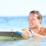 Beach fun - man bodyboarding on bodyboard — Stock Photo #26073269