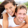 Couple happy having fun piggybacking — Stock Photo