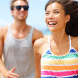 Young happy couple laughing having fun on beach — Stock Photo #26073309