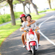 Scooter - couple driving in summer — Stock Photo