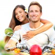 Happy young couple in love on scooter - Stock Photo