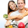Couple on scooter in love - Stock Photo