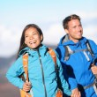 Happy interracial couple hiking — Stock Photo #26073431