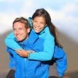 Happy hiking couple piggyback — Stock Photo