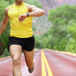 Running with heart rate monitor sports watch — Stock Photo
