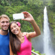 Couple tourists taking self portrait on Hawaii - Stock Photo