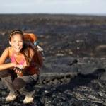 Hiker showing lava on Big Island, Hawaii — Stock Photo #26073739