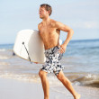 Beach water sports surfing man with body surfboard — Stock Photo