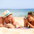 Beach fun couple travel - woman taking photo — Stock Photo