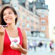 Tourist woman eating ice cream in Quebec City — Stock Photo