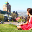 Stock Photo: Quebec City with Chateau Frontenac and woman