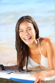 Water sport fun - beach woman bodyboarding surfing — Stock Photo
