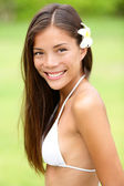 Bikini girl wearing Hawaiian flower smiling fresh — Stock Photo