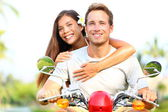 Happy young couple in love on scooter — Stock Photo
