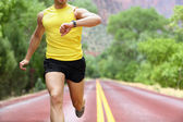 Running with heart rate monitor sports watch — Stok fotoğraf