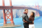 Golden gate bridge happy travel couple — Stock Photo