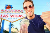 Las Vegas man winning money — Stock Photo