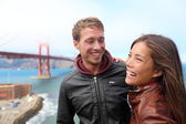 Happy young couple laughing, San Francisco — Stock Photo