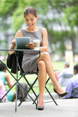 Businesswoman on break in park — Stock Photo