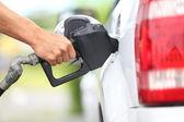 Pumping gas at gas pump — Stock Photo