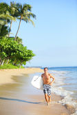 Beach lifestyle man surfer with surfing bodyboard — Stock Photo