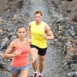 Runners couple running on trail in cross country — Stock Photo #26346179