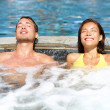 Spa couple relaxing enjoying jacuzzi hot tub — Stock Photo #26346299