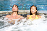 Spa couple relaxing enjoying jacuzzi hot tub — Stock Photo