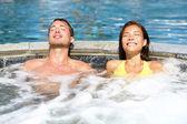 Spa couple relaxing enjoying jacuzzi hot tub — Stock Photo