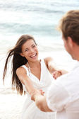 Beach summer vacation fun with playful couple — Stock Photo