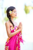 Meditating spiritual woman in meditation on beach — Stock Photo