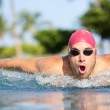 Swimmer man swimming butterfly strokes in pool — Stock Photo #27487351
