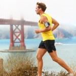 Man jogging - male running in San Francisco — Stock Photo #27487391