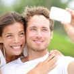 Couple fun taking self-portrait picture photos — Stock Photo