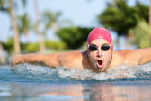 Swimmer man swimming butterfly strokes in pool — Stock Photo