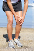 Running injury - Man out jogging with knee pain — Stock Photo