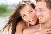 Happy romantic couple on beach in love — Stock Photo