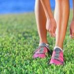 Running shoes - closeup of woman tying shoe laces — Stock Photo