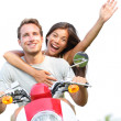 Couple on scooter in love happy together — Stock Photo #28193121