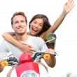 Couple on scooter in love happy together — Stock Photo