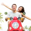 Happy free freedom couple driving scooter — Stock Photo