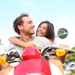 Couple driving scooter in love — Stock Photo