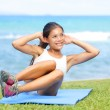 Fitness woman exercising sit ups outside — Stock Photo